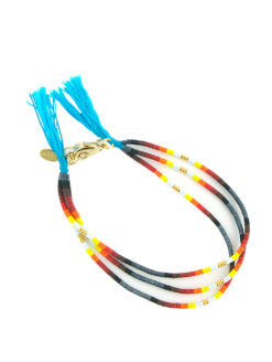 Shashi's ombre clasp black bracelet is another gypsy-inspired piece detailing ombre multi-colored plastic-glass beading, gold plated brass clasp closure, and an baby blue threaded finish. Layer, stack, or mix and match these top-line bracelets to your hearts content.