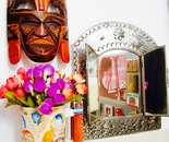 African mask, flowers & mirror