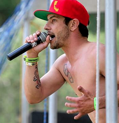 3upFront vocalist Adam Pierce entertains the crowd at Roaring Camp in Felton on Sunday afternoon during the Redwood Mountain Fair. (Kevin Johnson)
