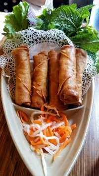 Chaû Gioø, Eggroll – crispy rice paper rolls filled with pork, wood ear mushroom, clear vermicelli & vegetables served with Asian greens & lime chili fish sauce