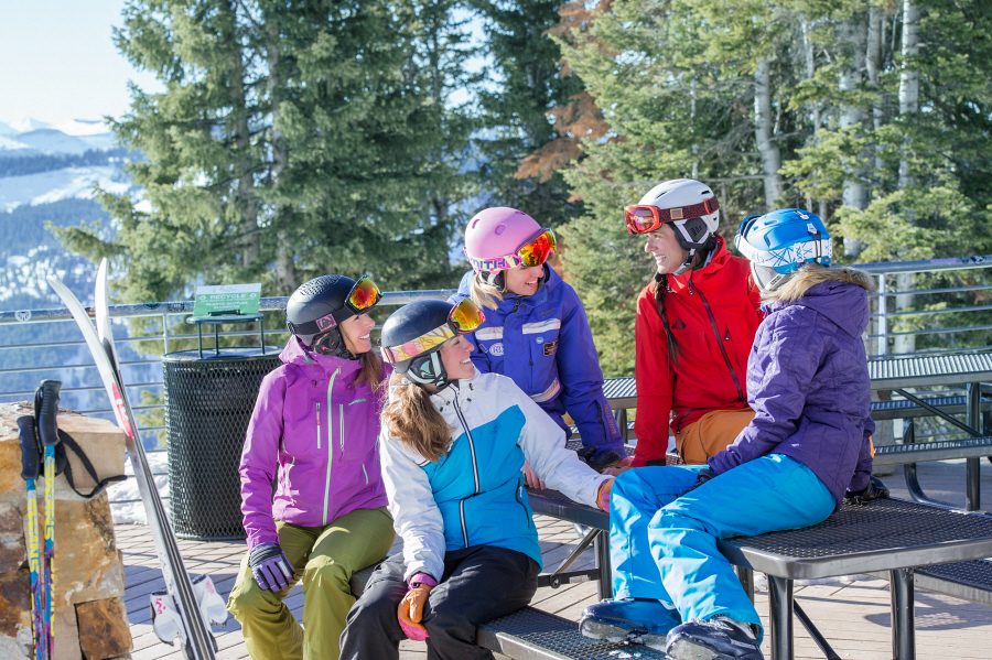 A ski instructor and her women's Ultimate Four group pause from a lesson to soak in a beautiful bluebird day at Vail.