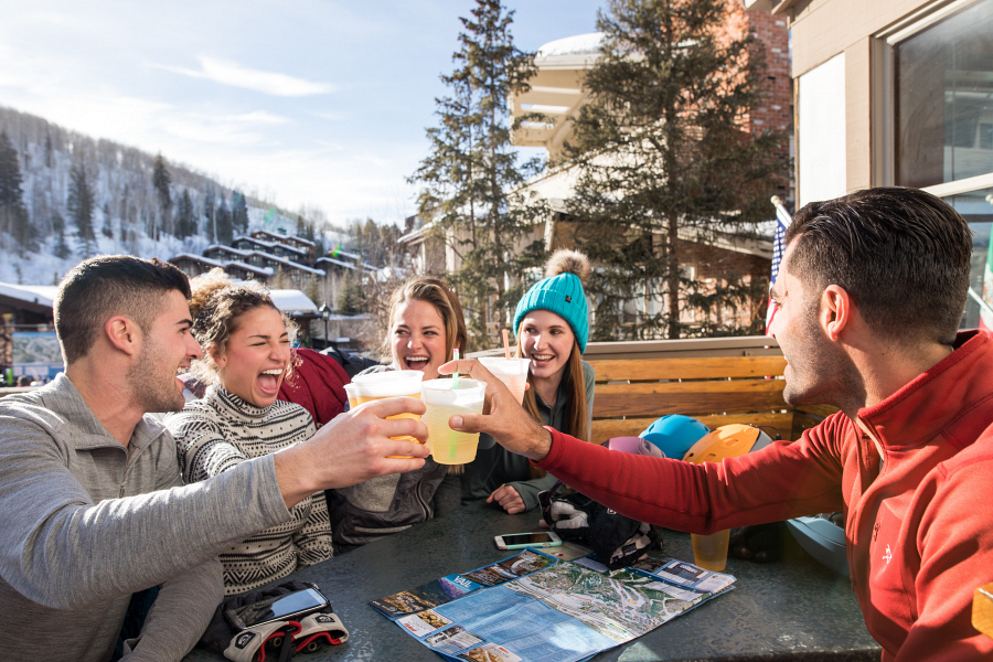 Young and Independents enjoy apres after skiing in Vail, CO.