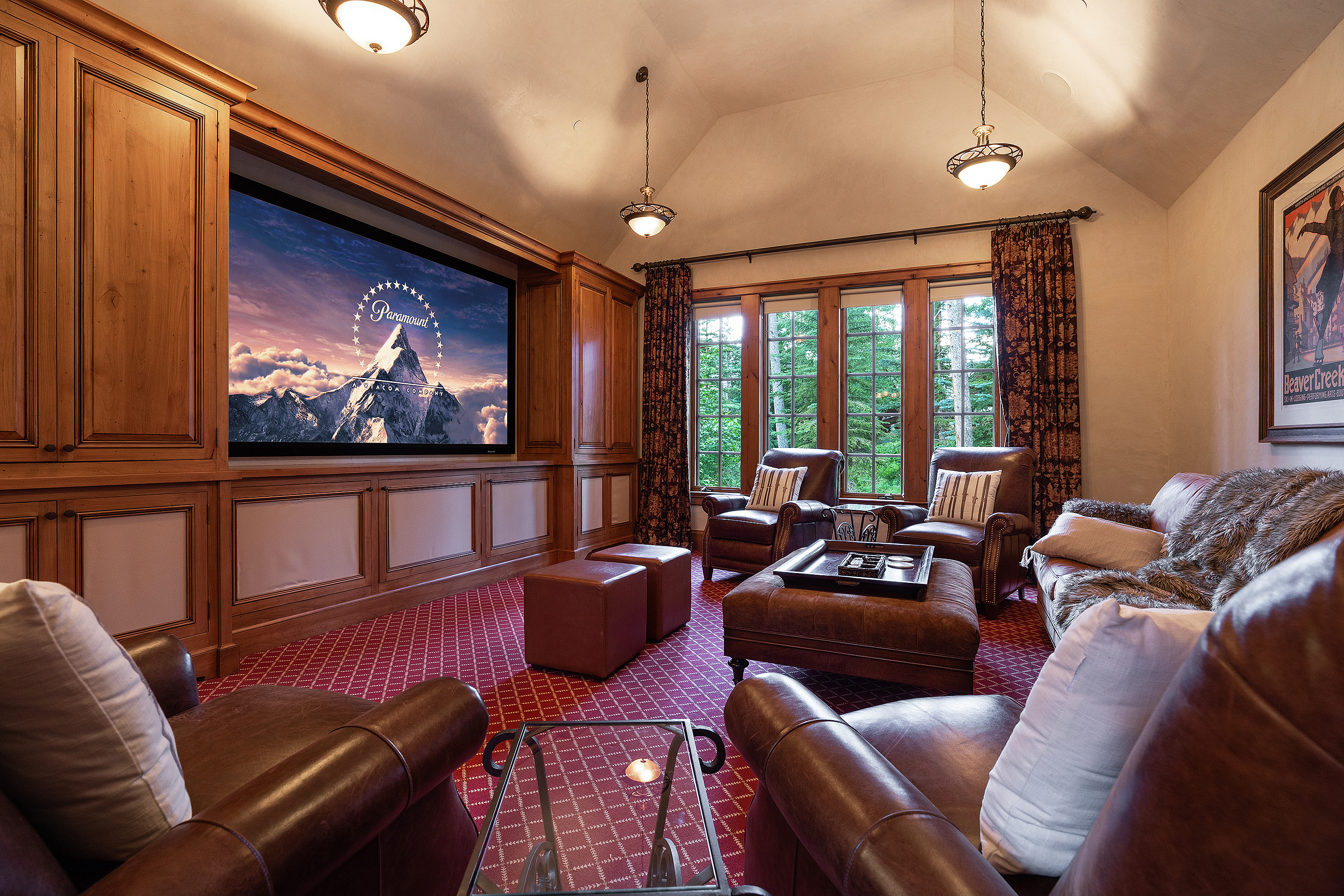 Long ski days call for hot chocolate and a cozy movie in this custom designed theatre.
