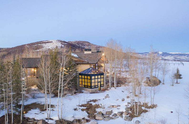 Colorado wintery exterior of luxury home - 909 Ute Forest Lane