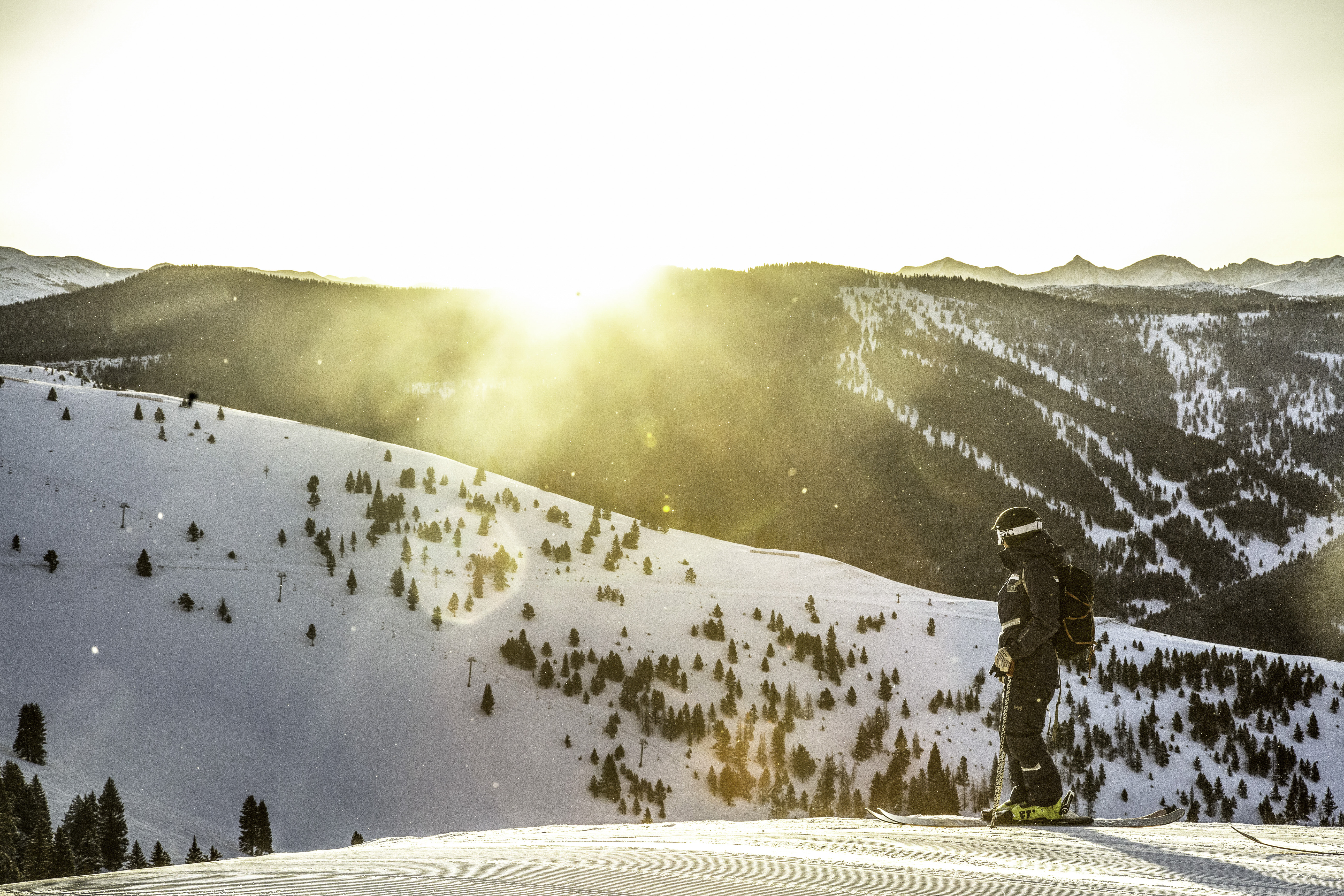Vail Resorts employee on the mountain during sunrise