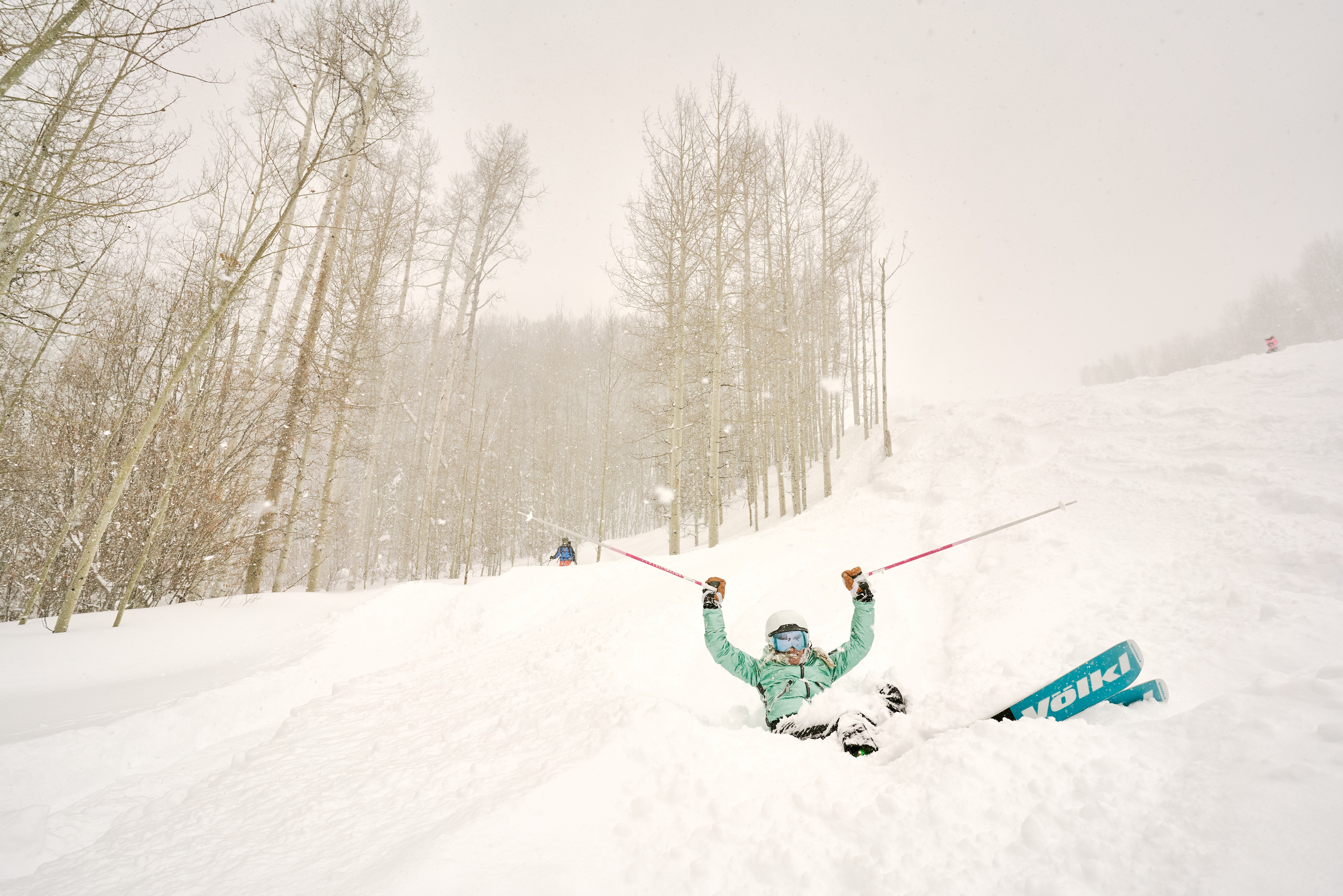 Skier falls on a powder day