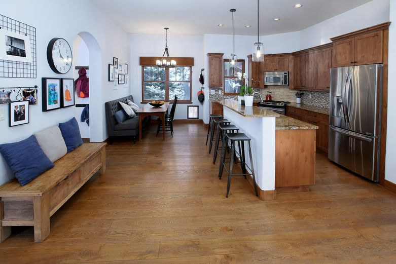 Kitchen with breakfast nook and bar in single-family home for sale