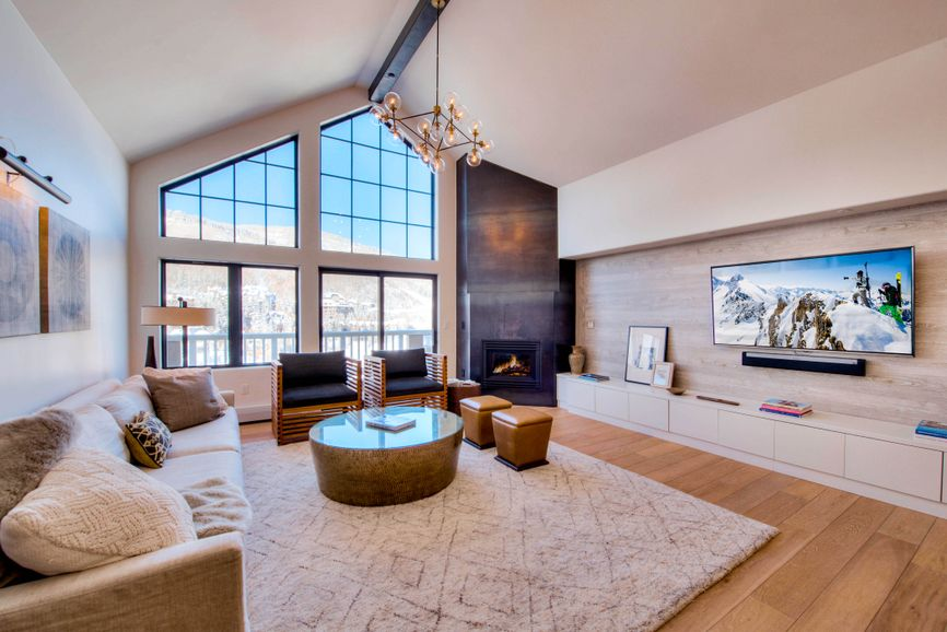 Prepping your home for sale - well lit living room of luxury mountain ski condo