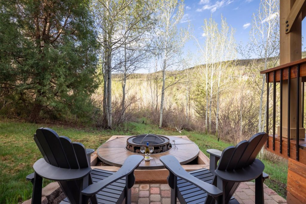 Exterior of new luxury mountain listing with plenty of outdoor living