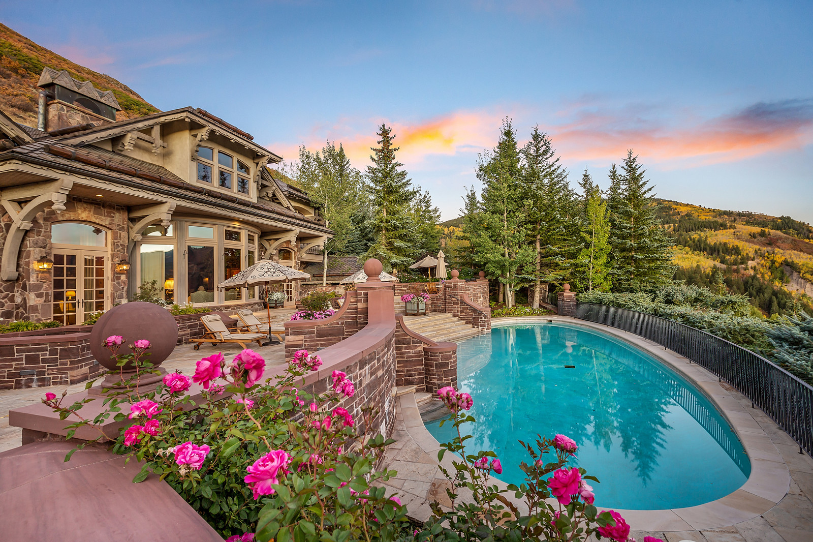 Luxury mountain home with expansive pool and patio