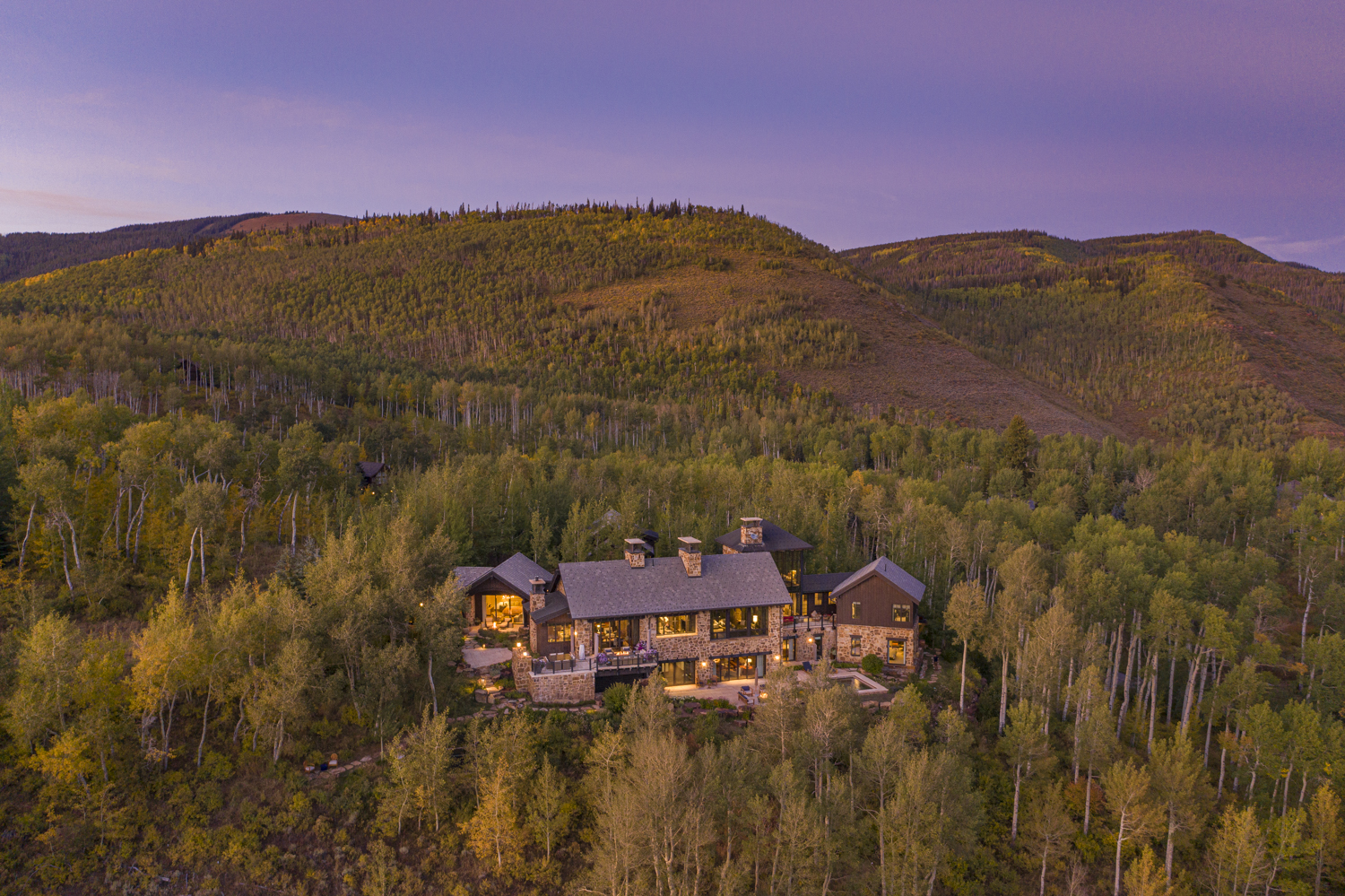 Aerial view of mountain luxury home set in an aspen grove