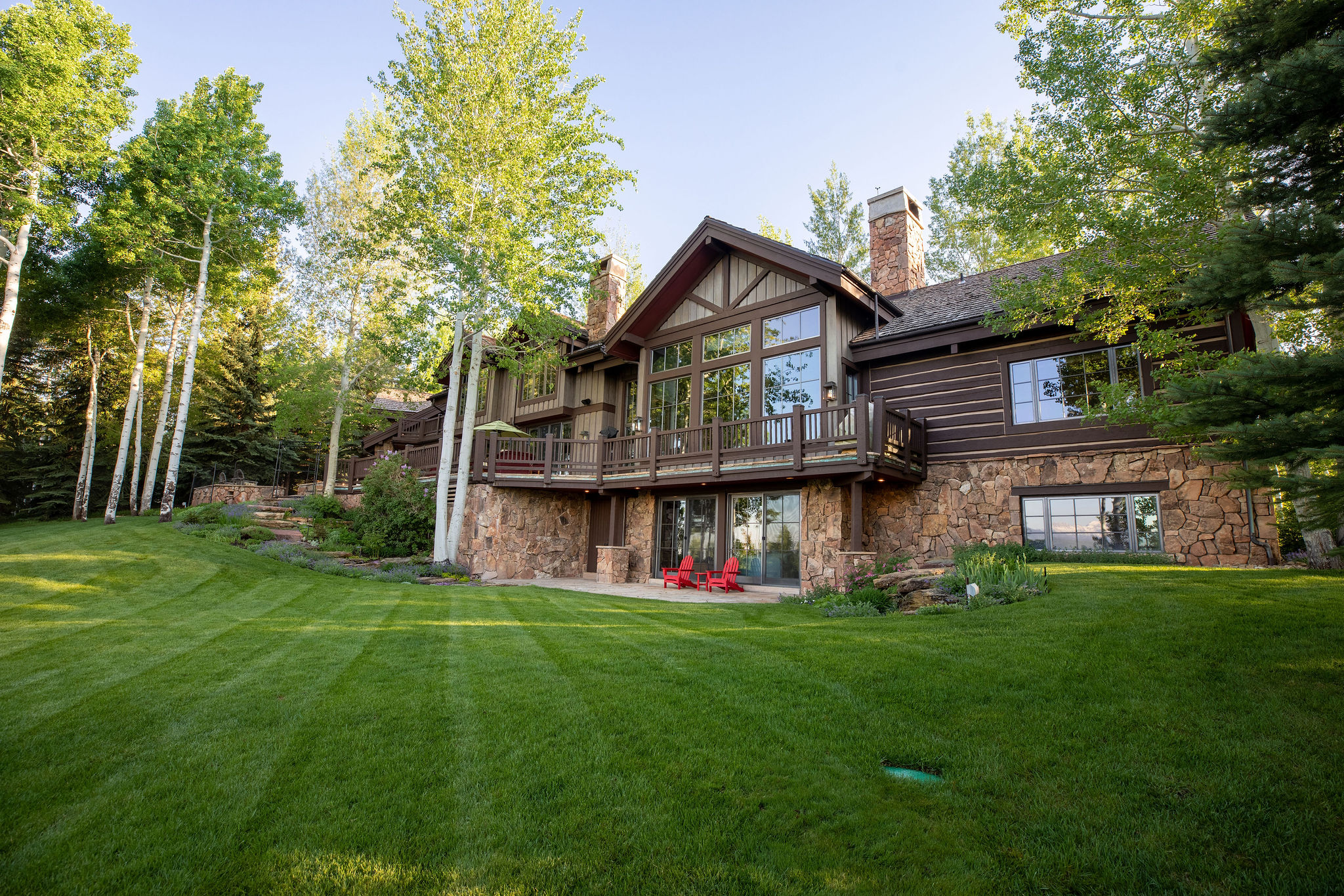 Pristine lawn and exterior of luxury mountain home