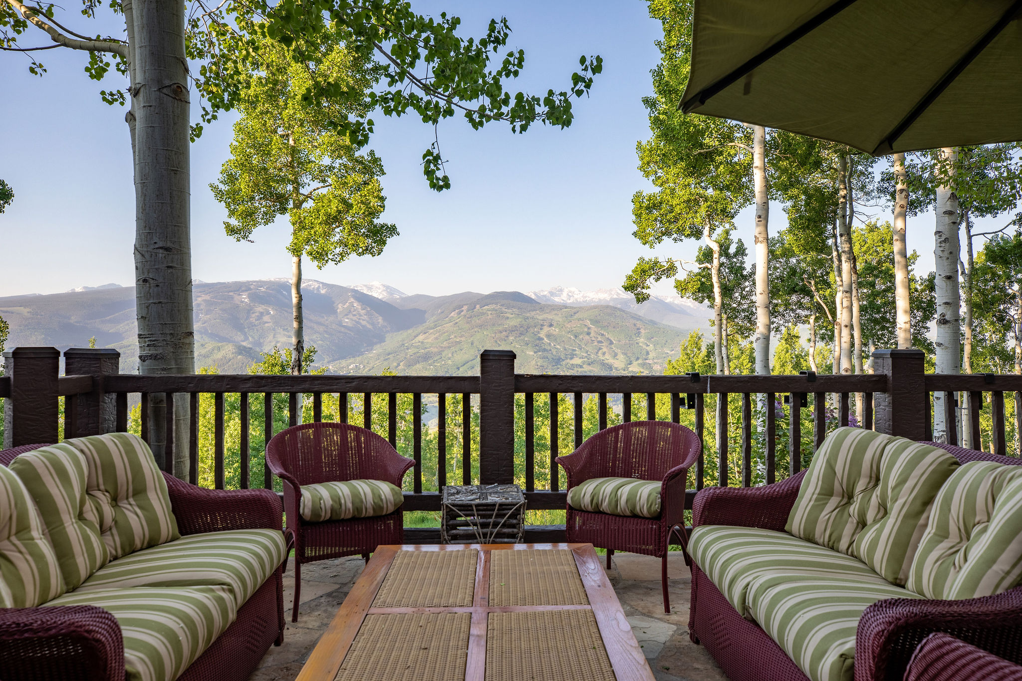 Summertime deck views from luxury mountain home