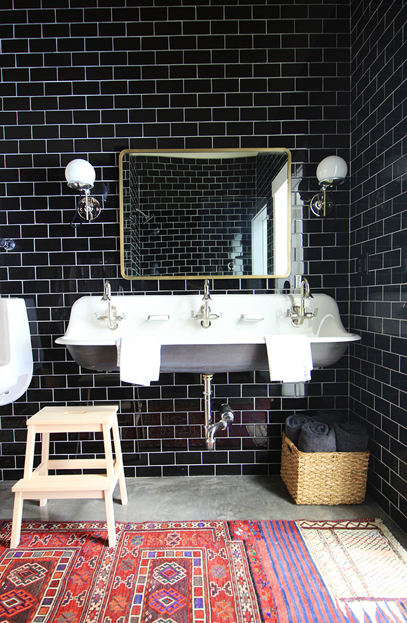You Don't Need a Downtown Loft to Enjoy Industrial Bathroom Light Fixtures