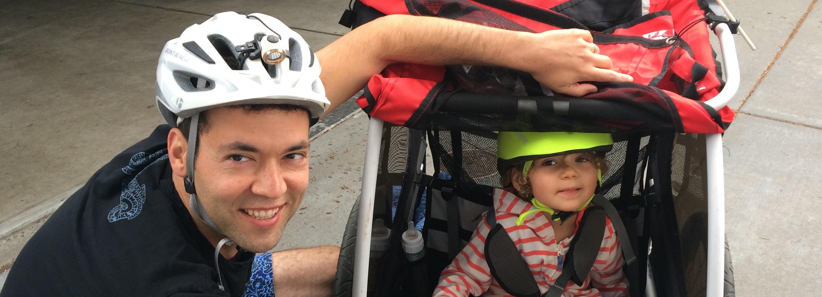 David-and-Naomi-Zeltser-in-bike-trailer