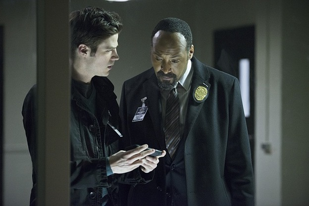 """The Flash -- """"Tricksters"""" -- Image FLA117A_0270b -- Pictured: (L-R) Grant Gustin as Barry Allen and Jesse L. Martin as Detective Joe West -- Photo: Diyah Pera/The CW -- © 2015 The CW Network, LLC. All rights reserved."""