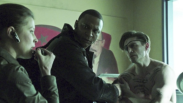 "Arrow--""Suicidal Tendencies""--Image AR317A_SG_0055--Pictured (L-R):  Audrey Marie Anderson as Lyla Michaels, David Ramsey as John Diggle, and Michael Rowe as Floyd Lawton/Deadshot--Photo: The CW--© 2015 The CW Network, LLC. All rights reserved."
