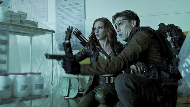 ".Arrow--""Suicidal Tendencies""--Image AR317A_0034b--Pictured (L-R): Amy Gumenick as Cupid and Michael Rowe as Floyd Lawton/Deadshot--Photo: The CW--© 2015 The CW Network, LLC. All rights reserved."