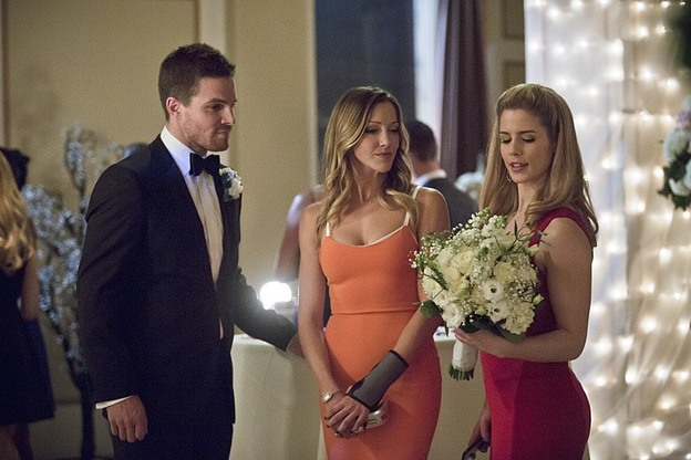 "Arrow--""Suicidal Tendencies""--Image AR317A_0313b--Pictured (L-R):  Stephen Amell as Oliver Queen, Katie Cassady as Laurel Lance, and Emily Bett Rickards as Felicity Smoak,--Photo: Katie Yu/The CW--© 2015 The CW Network, LLC. All rights reserved."