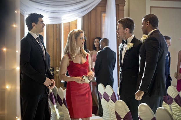 "Arrow--""Suicidal Tendencies""--Image AR317A_0008b--Pictured (L-R): Brandon Routh as Ray Palmer, Emily Bett Rickards as Felicity Smoak, Stephen Amell as Oliver Queen, and David Ramsey as John Diggle--Photo: Katie Yu/The CW--© 2015 The CW Network, LLC. All rights reserved."