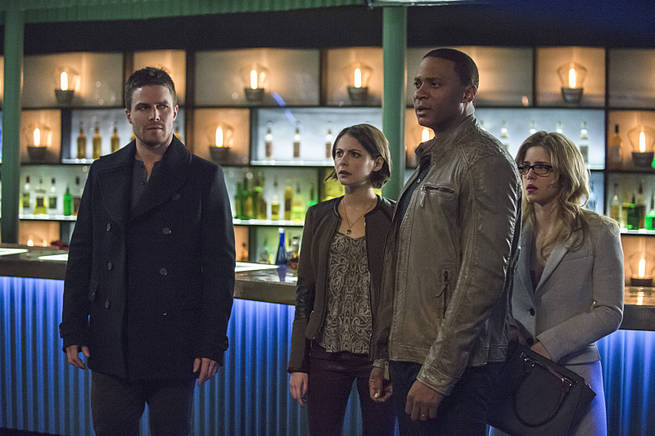 "Arrow -- ""Broken Arrow"" -- Image AR319B_0119b--Pictured (L-R): Stephen Amell as Oliver Queen, Willa Holland as Thea Queen, David Ramsey as John Diggle, and Emily Bett Rickards as Felicity Smoak -- Photo: Cate Cameron/The CW -- © 2015 The CW Network, LLC. All Rights Reserved."