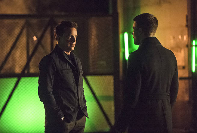 "Arrow -- ""Broken Arrow"" -- Image AR319A_0579b--Pictured (L-R): John Barrowman as Malcolm Merlyn and Stephen Amell as Oliver Queen -- Photo: Cate Cameron/The CW -- © 2015 The CW Network, LLC. All Rights Reserved."