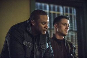 "Arrow -- ""Public Enemy"" -- Image AR318B_0329b -- Pictured (L-R): David Ramsey as John Diggle and Colton Haynes as Roy Harper -- Photo: Cate Cameron/The CW -- © 2015 The CW Network, LLC. All Rights Reserved."