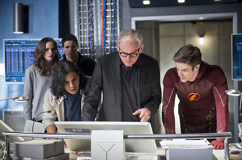 "The Flash -- ""Fast Enough"" -- Image FLA123A_0257b -- Pictured (L-R): Danielle Panabaker as Caitlin Snow, Robbie Amell as Ronnie, Carlos Valdes as Cisco Ramon, Victor Garber as Professor Stein, and Grant Gustin as Barry Allen -- Photo: Diyah Pera/The CW -- © 2015 The CW Network, LLC. All rights reserved."