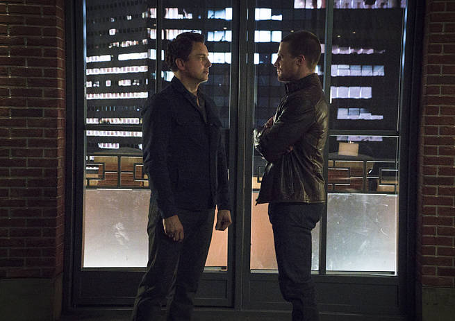 "Arrow -- ""My Name is Oliver Queen"" -- Image AR323B_0370b -- Pictured (L-R): John Barrowman as Malcolm Merlyn and Stephen Amell as Oliver Queen -- Photo: Liane Hentscher/The CW -- © 2015 The CW Network, LLC. All Rights Reserved."