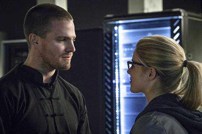 "Arrow -- ""My Name is Oliver Queen"" -- Image AR323B_0226b -- Pictured (L-R): Stephen Amell as Oliver Queen and Emily Bett Rickards as Felicity Smoak -- Photo: Liane Hentscher/The CW -- © 2015 The CW Network, LLC. All Rights Reserved."