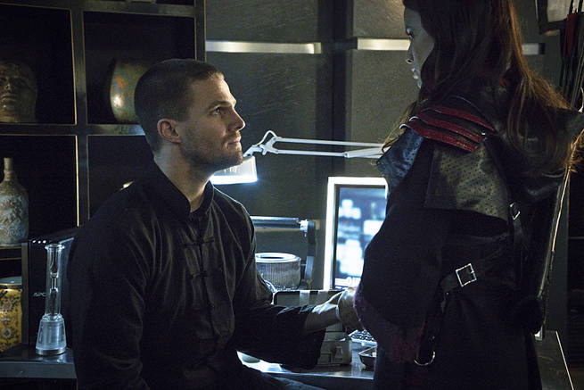 "Arrow -- ""My Name is Oliver Queen"" -- Image AR323B_0269b -- Pictured (L-R): Stephen Amell as Oliver Queen and Katrina Law as Nyssa al Ghul -- Photo: Liane Hentscher/The CW -- © 2015 The CW Network, LLC. All Rights Reserved."