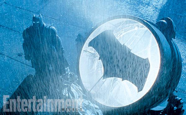 The Dark Knight summons The Man of Steel with the Batsignal