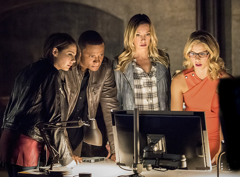"Arrow -- ""Green Arrow"" -- Image AR401A_0192bc -- Pictured (L-R): Willa Holland as Thea Queen, David Ramsey as John Diggle, Katie Cassidy as Laurel Lance and Emily Bett Rickards as Felicity Smoak  -- Photo: Dean Buscher /The CW -- © 2015 The CW Network, LLC. All Rights Reserved."