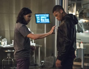 """The Flash -- """"The Fury of Firestorm"""" -- FLA204A_0259b2 -- Pictured (L-R): Carlos Valdes as Cisco Ramon and Franz Drameh as Jax Jackson -- Photo: Cate Cameron /The CW -- © 2015 The CW Network, LLC. All rights reserved."""