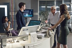"""The Flash -- """"The Fury of Firestorm"""" -- FLA204A_0074b -- Pictured (L-R): Carlos Valdes as Cisco Ramon, Grant Gustin as Barry Allen, Victor Garber as Professor Stein and Danielle Panabaker as Caitlin Snow-- Photo: Cate Cameron /The CW -- © 2015 The CW Network, LLC. All rights reserved."""
