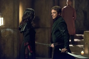 "Arrow -- ""Restoration"" -- Image AR403B_0071b.jpg -- Pictured (L-R): Katrina Law as Nyssa al Ghul and John Barrowman as Malcolm Merlyn -- Photo: Diyah Pera /The CW -- © 2015 The CW Network, LLC. All Rights Reserved."