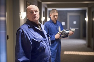 """The Flash -- """"Family of Rogues"""" -- Image FLA203b_0315b.jpg -- Pictured (L-R): Michael Ironside as Lewis Snart and Wentworth Miller as Leonard Snart -- Photo: Diyah Pera/The CW -- © 2015 The CW Network, LLC. All rights reserved."""