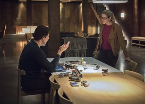 """Arrow -- """"Brotherhood"""" -- Image AR407A_0290b.jpg -- Pictured (L-R): Brandon Routh as Ray Palmer and Emily Bett Rickards as Felicity Smoak -- Photo: Dean Buscher/The CW -- © 2015 The CW Network, LLC. All Rights Reserved."""