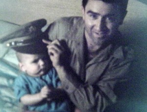 Jerry Siegel holds his son Mike