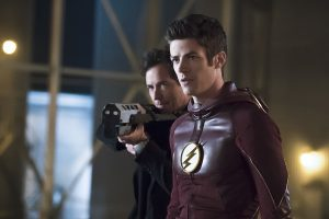 """The Flash -- """"The Race of His Life"""" -- Image: FLA223b_0065b.jpg -- Pictured (L-R): Tom Cavanagh as Harrison Wells and Grant Gustin as Barry Allen -- Photo: Katie Yu/The CW -- © 2016 The CW Network, LLC. All rights reserved."""