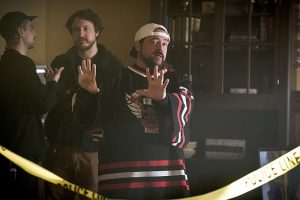 "The Flash -- "" The Runaway Dinosaur"" -- Image: FLA221a_bts_0305b.jpg -- Pictured: Behind the scenes with Kevin Smith -- Photo: Katie Yu/The CW -- © 2016 The CW Network, LLC. All rights reserved."