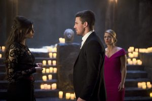 "Arrow -- ""Genesis"" -- Image AR420b_0080b.jpg -- Pictured (L-R): Gabriella Wright as Esrin Fortuna, Stephen Amell as Oliver Queen and Emily Bett Rickards as Felicity Smoak -- Photo: Diyah Pera/The CW -- © 2016 The CW Network, LLC. All Rights Reserved."