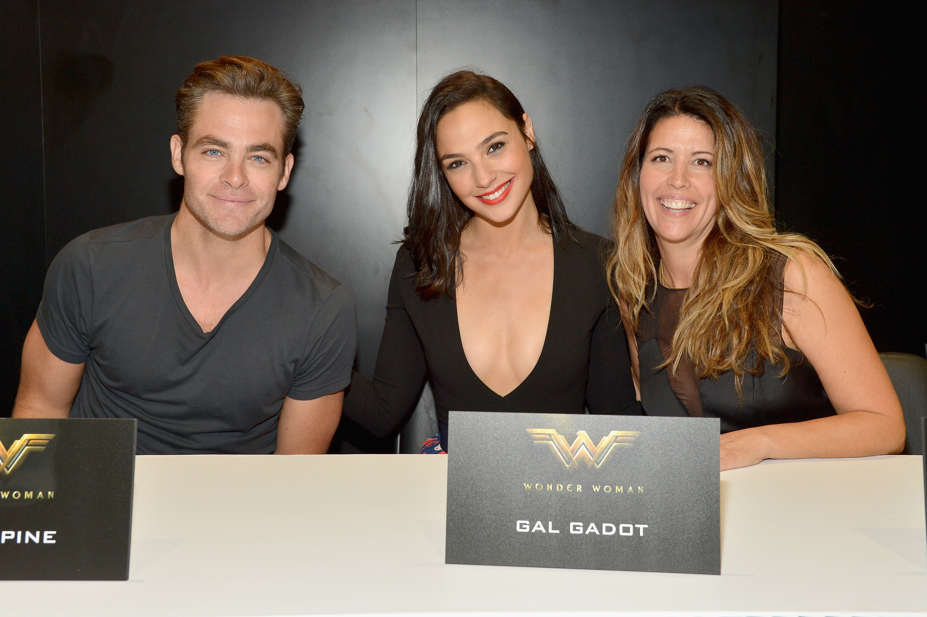 SAN DIEGO, CA - JULY 23: (L-R) Actors Chris Pine, Gal Dagot and director Patty Jenkins from the 2017 feature film Wonder Woman attend a cast signing autograph session for fans in DC's 2016 San Diego Comic-Con booth at San Diego Convention Center on July 23, 2016 in San Diego, California. (Photo by Charley Gallay/Getty Images for DC Entertainment) *** Local Caption *** Patty Jenkins;Chris Pine;Gal Dagot