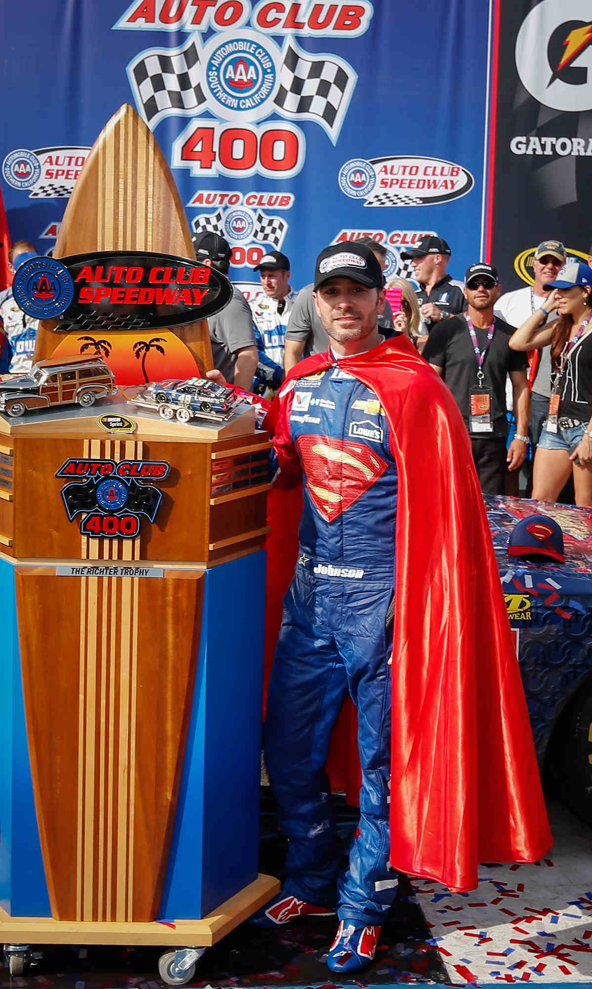 Jimmie Johnson, driver of the #48 LoweÕs/Superman Chevrolet SS, celebrates his 77th career victory Sunday, March 20, 2016 in the NASCAR Sprint Cup Series race at Auto Club Speedway in Fontana, California.  (Photo by Gregg Ellman for Chevy Racing)