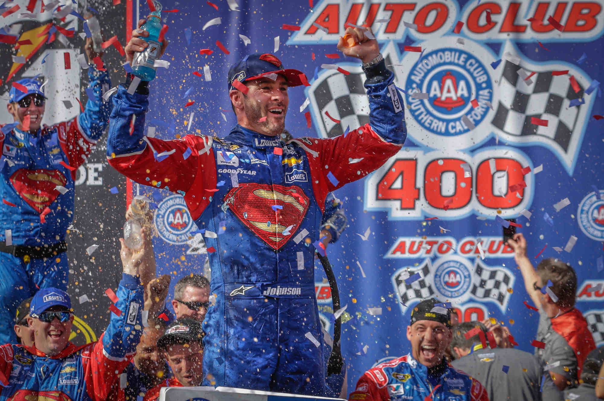 Jimmie Johnson, driver of the #48 LoweÕs/Superman Chevrolet SS, celebrates his 77th career victory, Sunday, March 20, 2016 in the NASCAR Sprint Cup Series race at Auto Club Speedway in Fontana, California. (Photo by Harold Hinson for Chevy Racing)