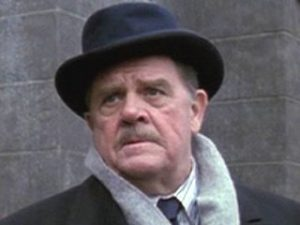 Pat Hingle as Commissioner Gordon