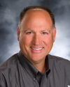 Bruce M. Huber, Managing Broker
