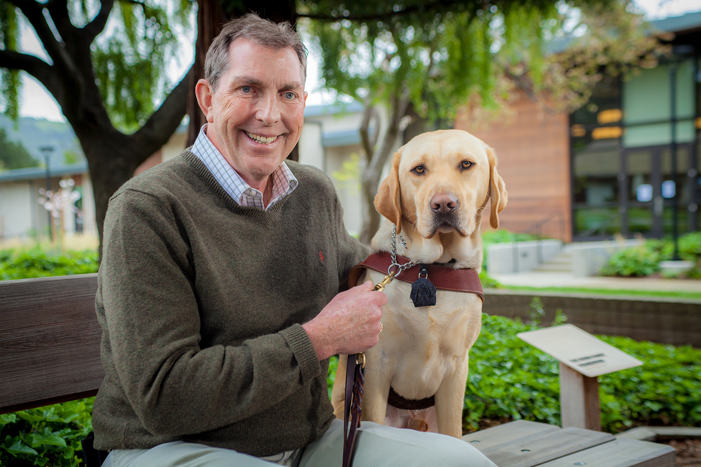 Tom Kowalski with his yellow Lab guide dog Dynamo.