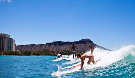 Women surfing   Hawaii Tourism Authority (HTA) / Tor Johnson