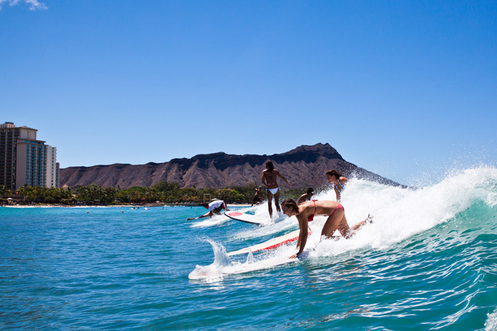 Women surfing | Hawaii Tourism Authority (HTA) / Tor Johnson